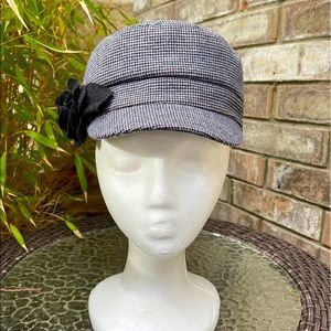 Tweed pageboy cap with fabric flower.